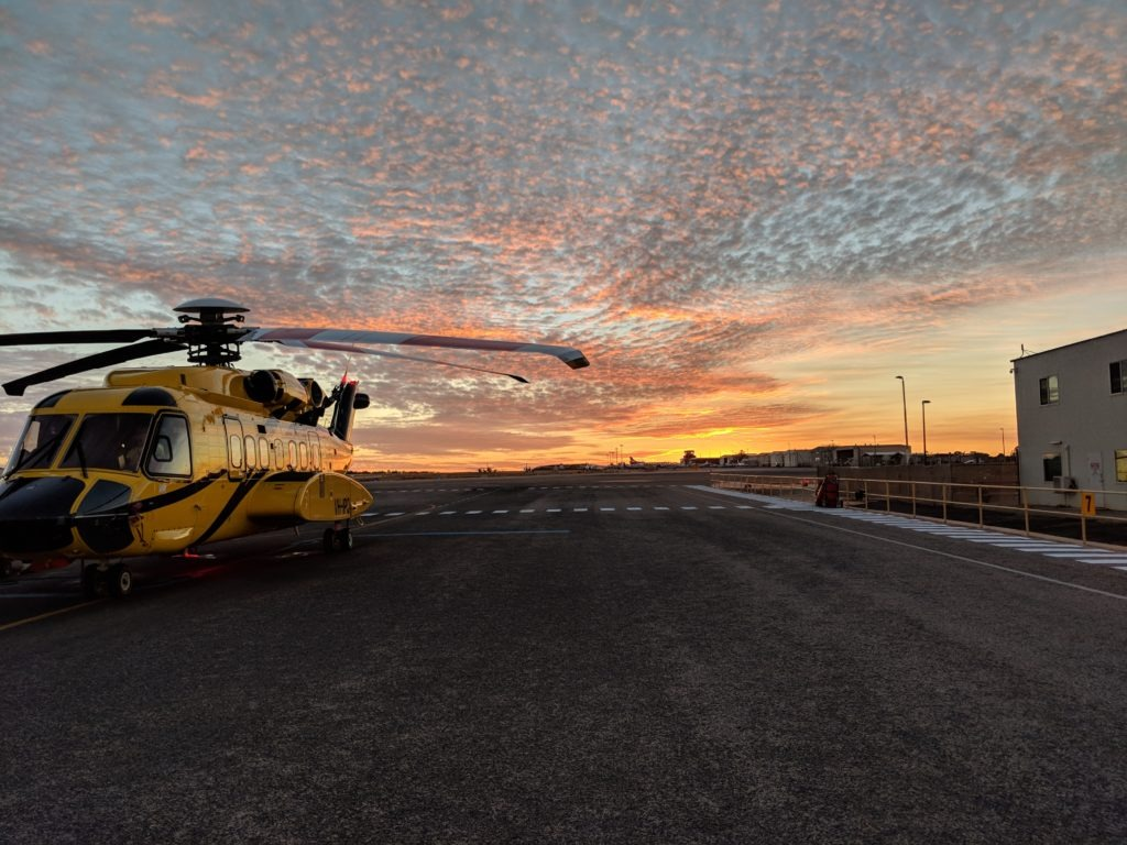 helicopter with sunset